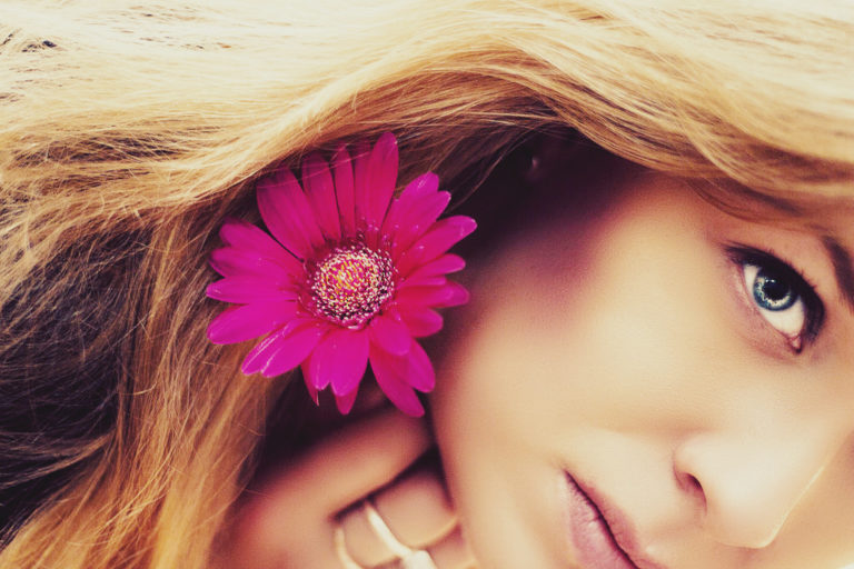 beautiful blonde girl with pink flower